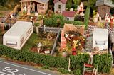 Faller 180495 two allotments with Caravan